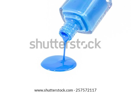 Blue nail polish pouring on the white background