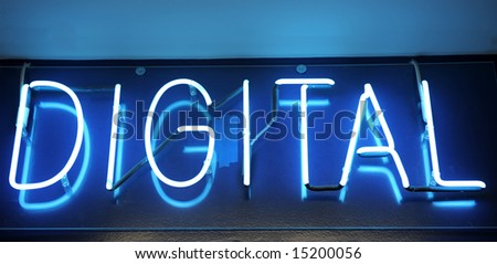 Blue neon sign with the word Digital