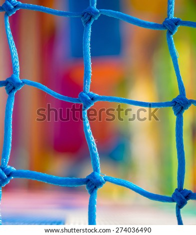 Blue net closeup in children playground. Colorful plastic background - stock photo