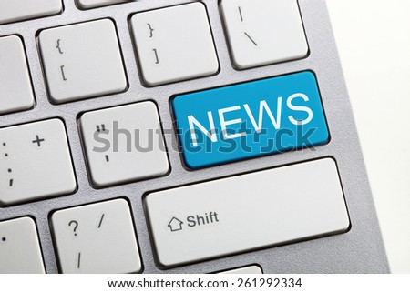 Blue News button on a computer keyboard.