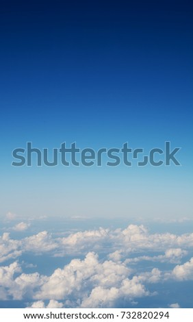 Blue night cloud sky background, aerial view from airplane window.