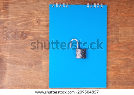 Blue notebook with lock, concept of data security