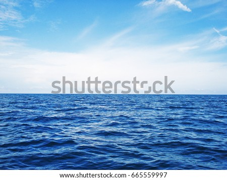 blue ocean sea with soft wave and blue sky on sunny day located in  Ko Bulon Leh, a small island in Satun Province, on the Andaman (west) coast of the south of Thailand