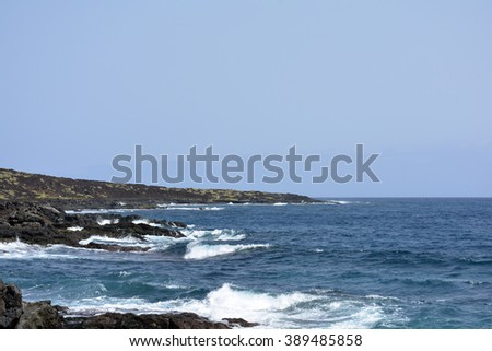 blue ocean water and a rugged volcanic coastline, northern Tenerife - stock photo