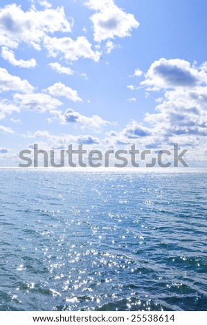 Blue ocean water and sunny sky background