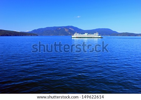 Blue ocean water with a ferry boat on the Puget Sound, Washington, USA. - stock photo