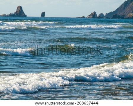 Blue Ocean Waves Breaking on the Beach on a Clear Day - stock photo