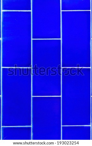 Blue of diamonds pattern tile wall.