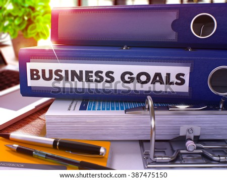 Blue Office Folder with Inscription Business Goals on Office Desktop with Office Supplies and Modern Laptop. Business Goals Business Concept on Blurred Background. Business Goals - Toned Image. 3D. - stock photo