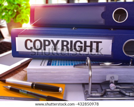 Blue Office Folder with Inscription Copyright on Office Desktop with Office Supplies and Modern Laptop. Copyright Business Concept on Blurred Background. Copyright - Toned Image. 3D. - stock photo