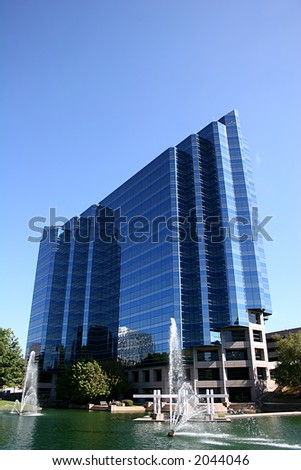 Blue Office tower on lake with fountain