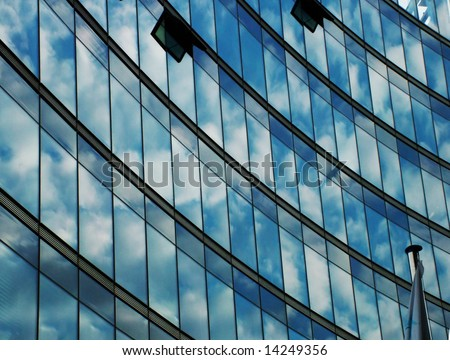 blue office wall with reflected clouds