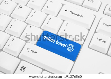 Blue online travel button on the white keyboard  - stock photo