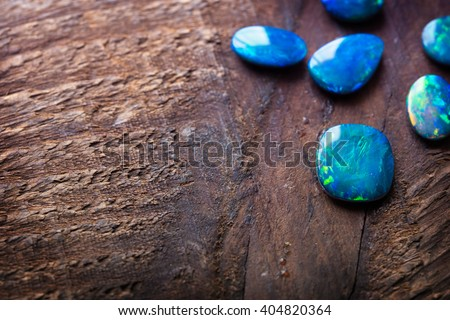 Blue Opals on rustic wooden table. Shallow depth of field. - stock photo