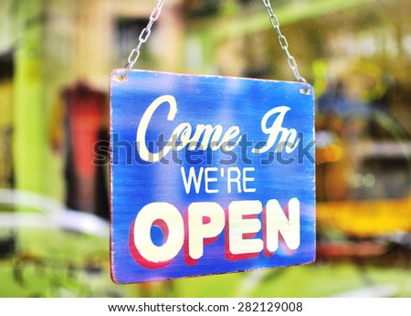Blue open sign in the street cafe - stock photo
