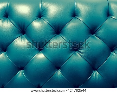Blue or green texture of the sofa, abstract background. - stock photo