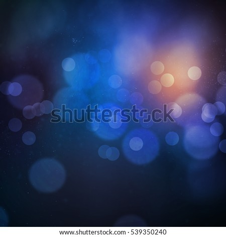 Blue orange bokeh with dust, glitter, sparkles