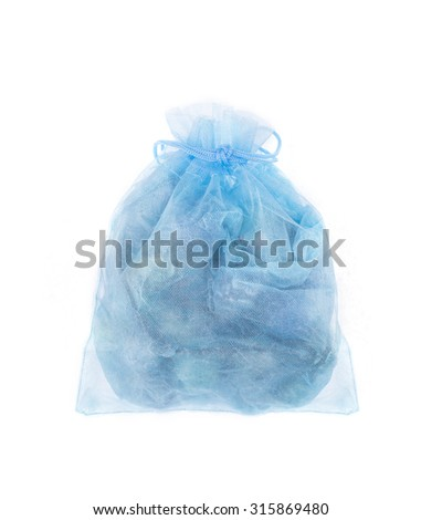Blue organza jewelry bag with bracelet inside. Isolated on white background.