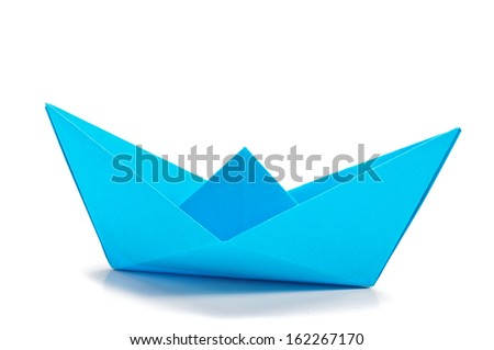 Blue origami ship  side  - stock photo