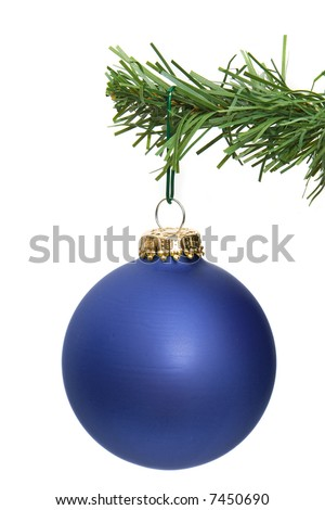 blue ornament hanging on a pine tree branch