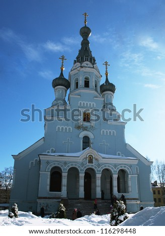Blue orthodox cathedral building surrounded with snow drifts - stock photo