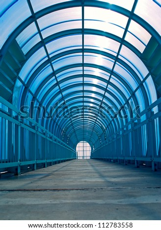 Blue overhead pedestrian tunnel - stock photo