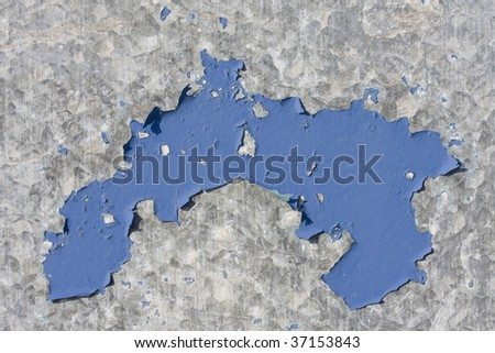 Blue paint flaking on  grey metal surface texture