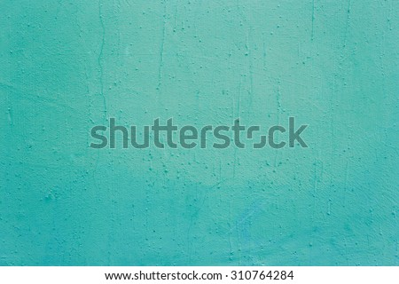 Blue painted concrete wall background - stock photo
