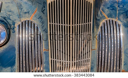 Blue painted vintage american car rusty metal grille close up details - stock photo
