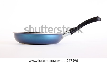Blue  pan for frying eggs. Side view - stock photo