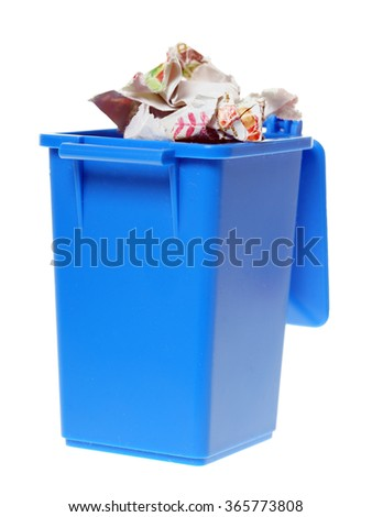 blue paper bin with paper waste isolated over a white background / Paper Waste - stock photo