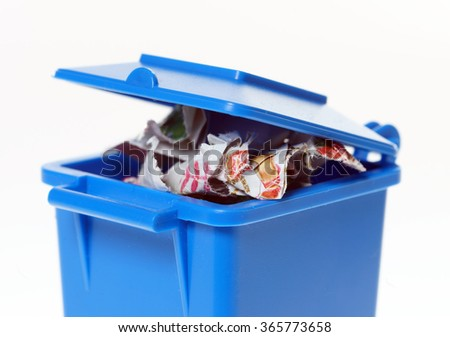 blue paper bin with paper waste / Paper Waste - stock photo