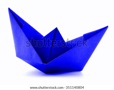 Blue paper navy origami sail boat, isolated on white background - stock photo