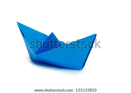 Blue paper ship on a white background - stock photo