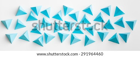 blue paper tetrahedrons on white background. abstract web banner - stock photo