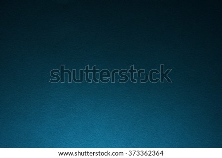 Blue paper texture with light from the bottom side - stock photo