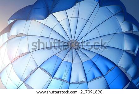 blue parachute - stock photo