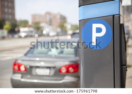 Blue parking sign with blurred cars in New York City - stock photo