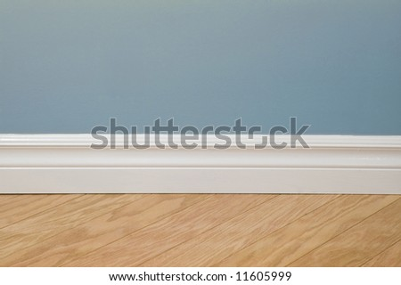 Blue pastel wall, baseboard and hardwood flooring
