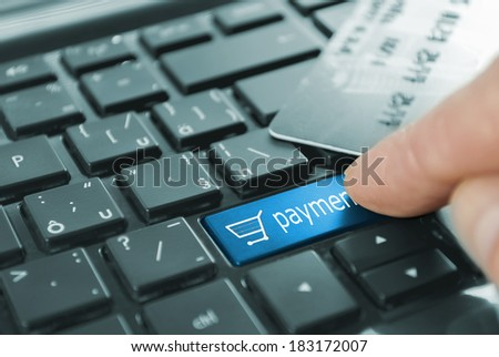 blue payment cart button or key on black keyboard