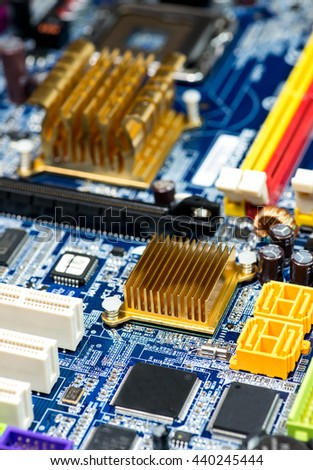 blue pcb board integrated circuit pc parts motherboard chip processor texture background - stock photo