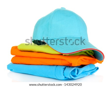 Blue peaked cap with T-shirts isolated on white