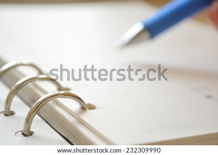 Blue pen business appointment calender to date for modern daily life in the city - stock photo