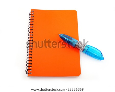 Blue pen on a red notebook