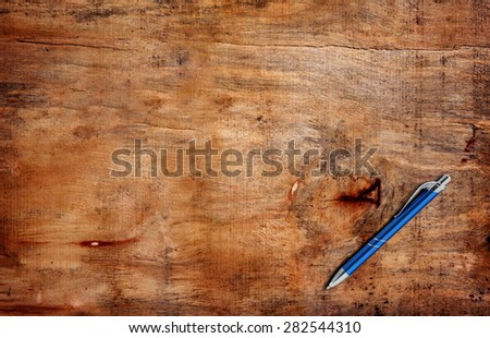 blue pen on the table - stock photo