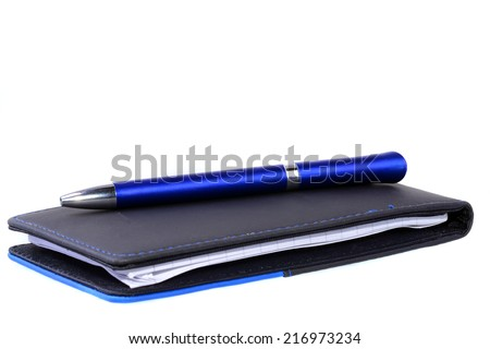 Blue pen over  note pad isolated on a white background