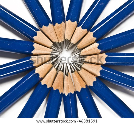 Blue pencils coalescing into a sun - stock photo