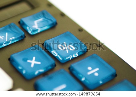 Blue percent key on plastic calculator, close up with shallow depth of field. - stock photo