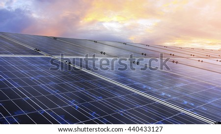 Blue photovoltaic solar panels on ground mounting at twilight ,Clean energy.