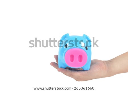Blue piggy bank in man hand isolated on white background, clipping path included. - stock photo